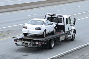 flat bed emergency towing service near me